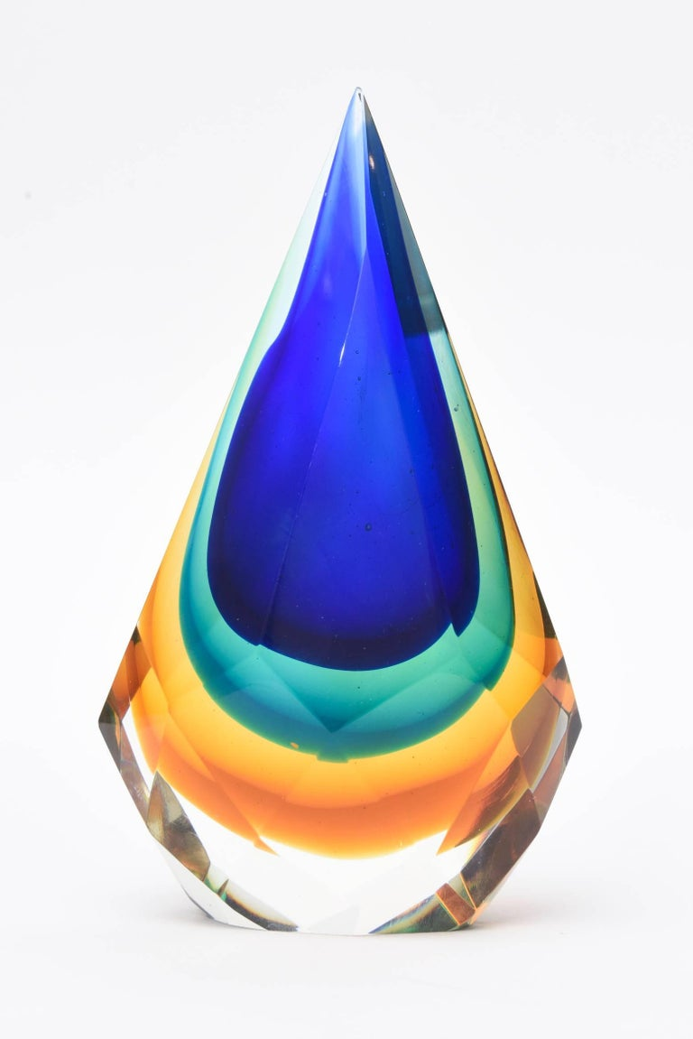 This stunning teardrop shaped Italian Murano diamond faceted sommerso glass sculpture/ paperweight/ desk accessory is most unusual. The layers of brilliant colors are cobalt blue, emerald green, amber to yellow to clear. The diamond faceted forms