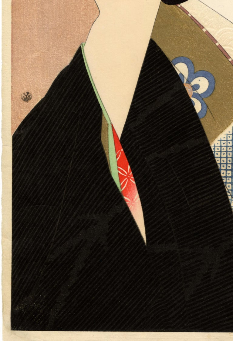 """Original Japanese woodblock print. """"Pupil of the Eye"""" from the """"Second Series of Modern Beauties"""". A beauty has turned to the left so that our view of her is oblique; the black of her outer kimono matches the deep black of her coiffure. With many"""