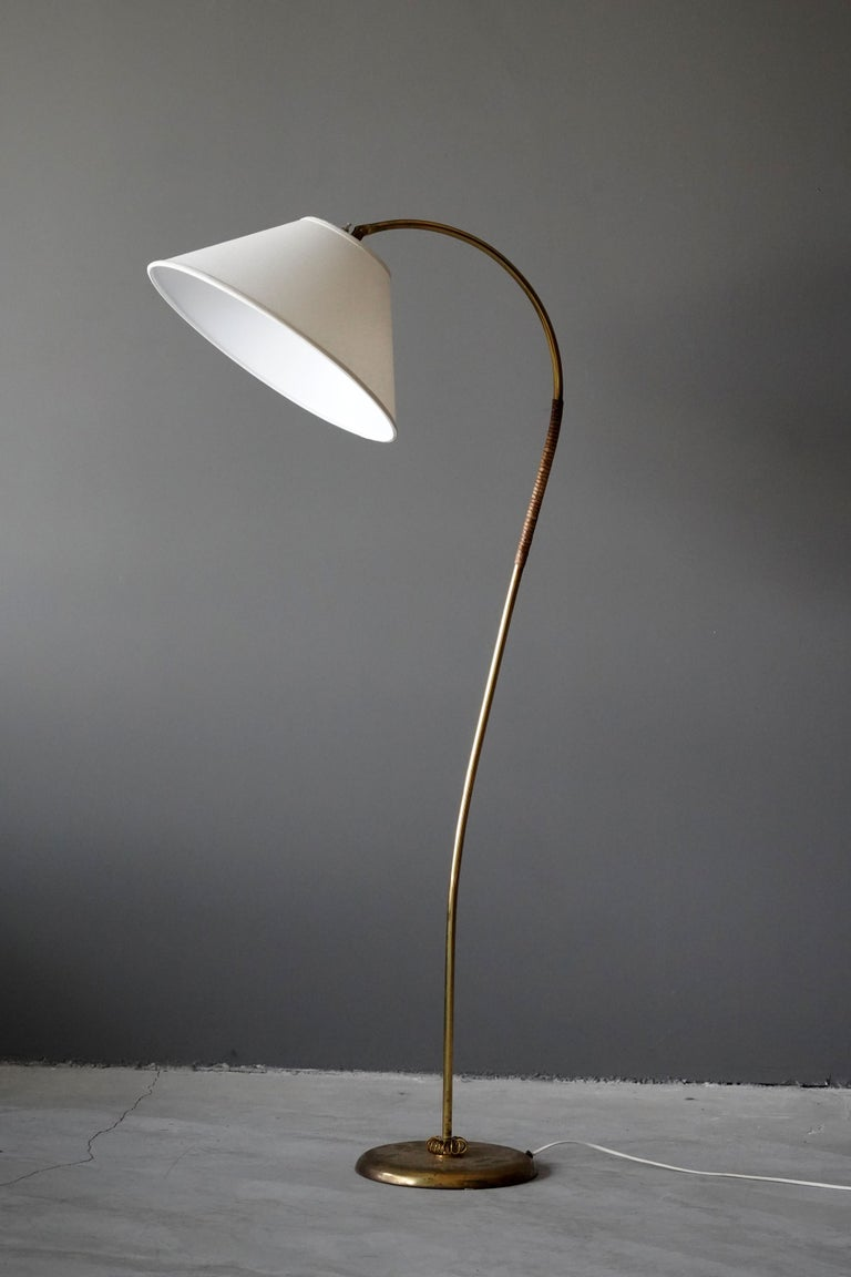 A rare floor by Finnish producer, Itsu. Stamped. Features superb details such as a brass-thread ribbon and original reed wrapping. Brand new high end lampshade.   Other notable lighting designers of the 20th century include Paavo Tynell, Alvar
