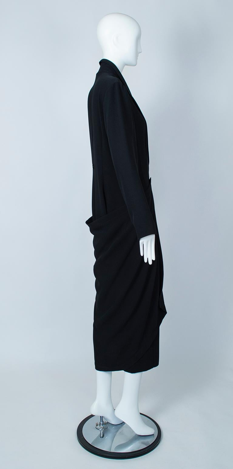 A wearable work of art, this sculptural hobble coat resembles some of the great deconstructionist garments of Rei Kawakubo, but was created by the Danish modernist Ivan Grundahl. Featuring a lean silhouette with a gentle princess hemline, the coat's