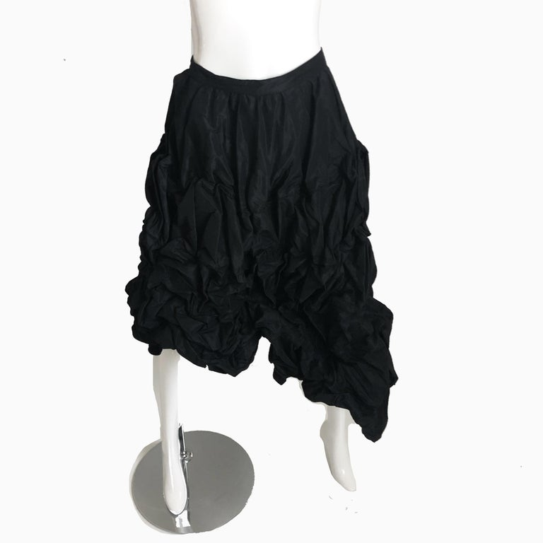 This incredibly rare sculptural skirt was made by Ivan Grundahl Copenhagen in 2010. Made from black microfiber, it features flexible wire boning throughout, allowing one to sculpt and shape the piece in a variety of ways, including use as an over