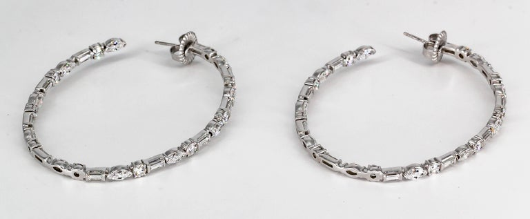 Modern diamond and 18K white gold large inside out hoop earrings by Ivanka Trump. They feature high grade baguette, round and marquise cut diamonds throughout, approx. 8.0cts total weight.   Hallmarks: Ivanka Trump, 750, reference numbers.
