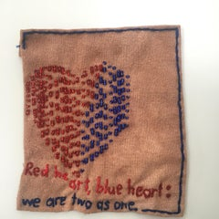 Heart - love narrative embroidery with blue red beads on brown vintage fabric