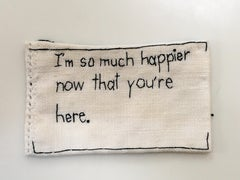 Much Happier - love narrative embroidery black thread on white vintage fabric