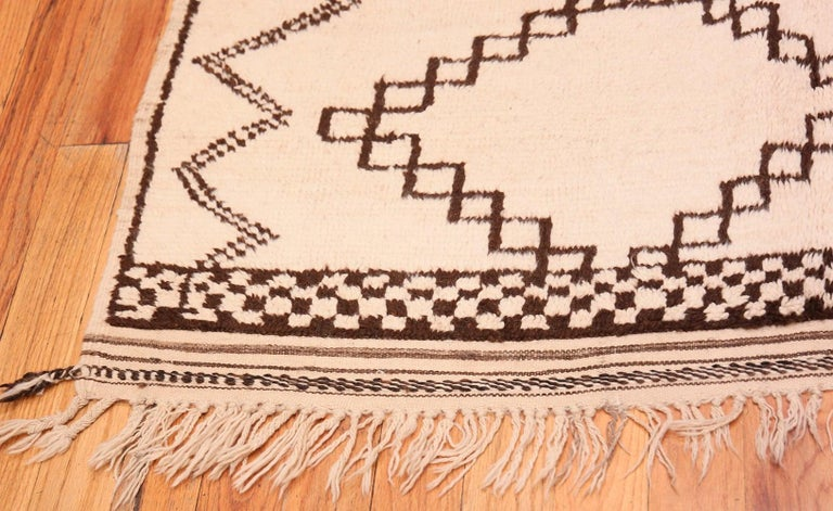 Tribal Ivory and Brown Moroccan Rug For Sale