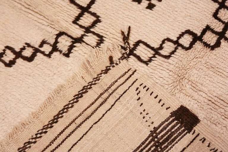20th Century Ivory and Brown Moroccan Rug For Sale