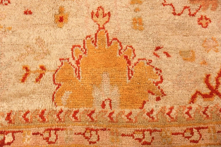 20th Century Ivory Antique Oushak Turkish Rug. Size: 13 ft 7 in x 15 ft 3 in(4.14 m x 4.65 m) For Sale