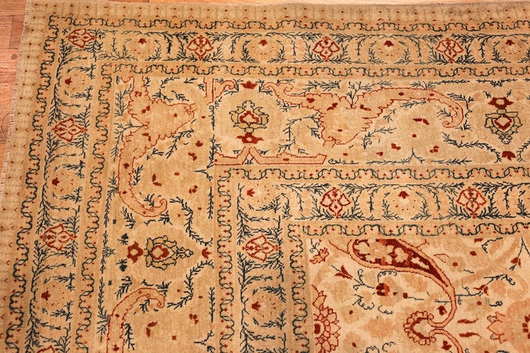 Breathtaking ivory background antique Tabriz Haji Jalili Persian rug, country of origin / rug type: Persian rug, date circa 1900. Size: 9 ft 2 in x 12 ft 9 in (2.79 m x 3.89 m)   A single unified background defines this rug, allowing the elements at