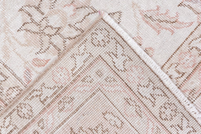 Hand-Knotted Ivory Field Turkish Oushak Carpet, circa 1940s, Lightly Distressed, Pink Accents For Sale