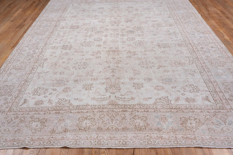 Mid-20th Century Ivory Field Turkish Oushak Carpet, circa 1940s, Lightly Distressed, Pink Accents For Sale