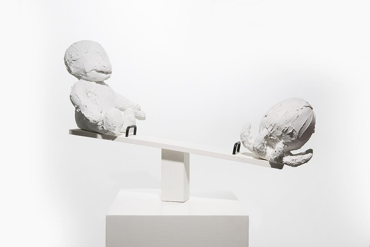 Sculpture of two figures on seesaw: 'Seesaw'