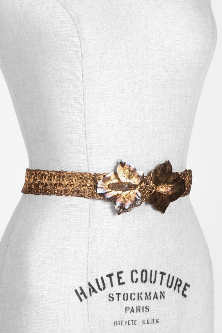 Unique c. 1970s woven metal belt with leaf design buckle that can be worn as a very cool long necklace too (see picture 6).  The alluring artisanal belt features a double ivy or maple leaf buckle in a patinized gold tone metal symbolizing either