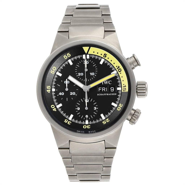 IWC Aquatimer GST Titanium Chronograph Day Date Mens Watch IW371903. Automatic self-winding chronograph movement. Titanium case 42.0 mm in diameter. Scratch resistant sapphire crystal. Black dial with index hour markers. Luminescent hands. Yellow