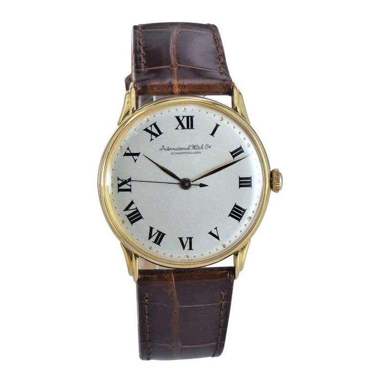 FACTORY / HOUSE:  I.W.C Schaffhausen / International  Watch Company STYLE / REFERENCE: Art Deco / Round Style METAL / MATERIAL: 18K Solid Yellow  DIMENSIONS:  38.5mm X 34mm CIRCA: 1950's MOVEMENT / CALIBER: Manual Winding / 18 Jewels  DIAL / HANDS: