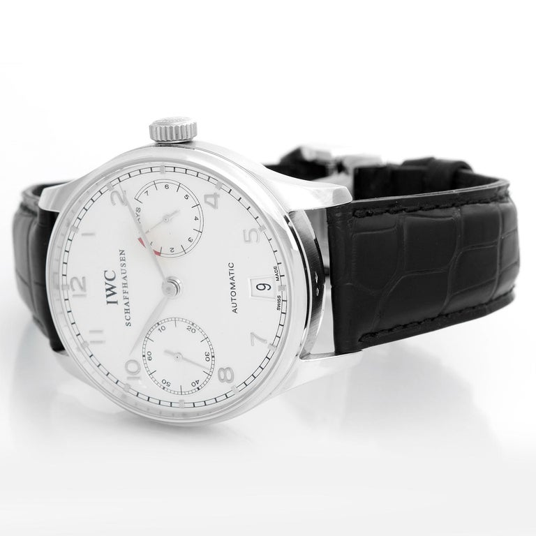 IWC Portugieser Platinum  Men's Watch IW500104 - Automatic winding. Platinum case with brushed finished edges ( 42 mm ). Silver dial with silver sub-dials with  Arabic numerals & Index hours. Black alligator strap with deployant buckle. Pre-owned