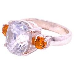 Gemjunky Sizzling White Cambodian Zircon and Mandarin Garnet Ring