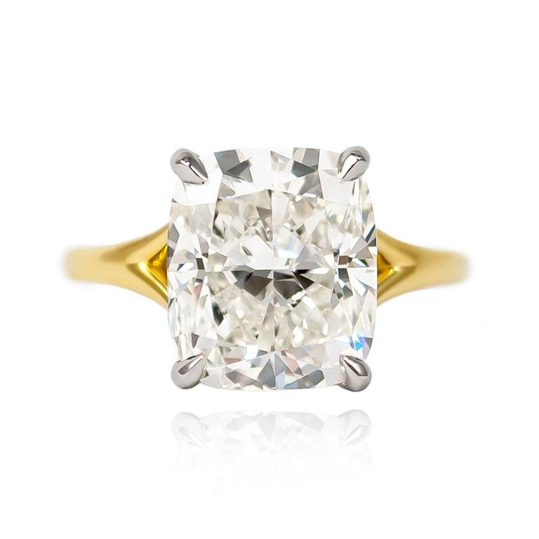 This new beauty from the J. Birnbach vault will make them stop and stare! Featuring a scintillating 6.01 carat Cushion Modified Brilliant of J color and VS1 clarity, this diamond is set in a handmade 18K Yellow Gold & Platinum split shank ring.