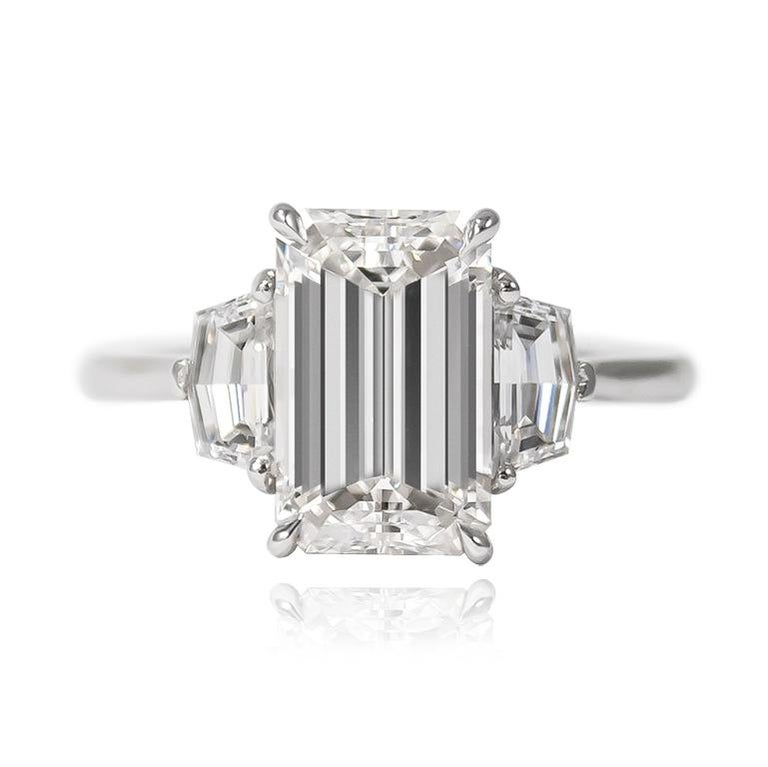 This fierce and edgy execution of a timeless classic is simply beyond description! A new favorite of the J. Birnbach family, this ring features a scintillating 3.00 ct Emerald cut diamond of E color and VS2 clarity. Set with a pair of epaulette