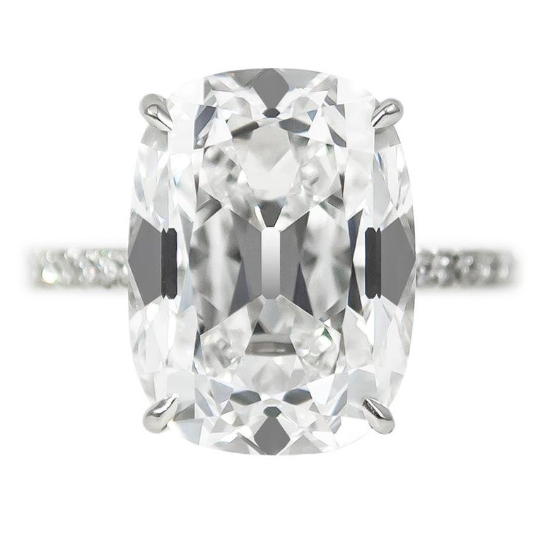 This gorgeous 10.01 ct Cushion Brilliant diamond of E color and VS2 clarity is a once-in-a-lifetime stone! Set in a fine, handmade platinum ring with brilliant round pavé details = 0.48 ctw. Charming and sophisticated, the distinct, hand-cut