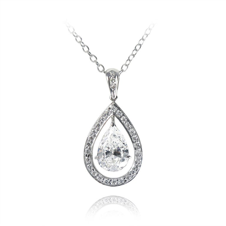 This charming and scintillating piece from the J. Birnbach workshop features a GIA certified 1.52 carat pear shape diamond of D color and I1 clarity set in a handmade, 18K white gold pavé pendant = 0.18 carat total weight. One of the most pleasant