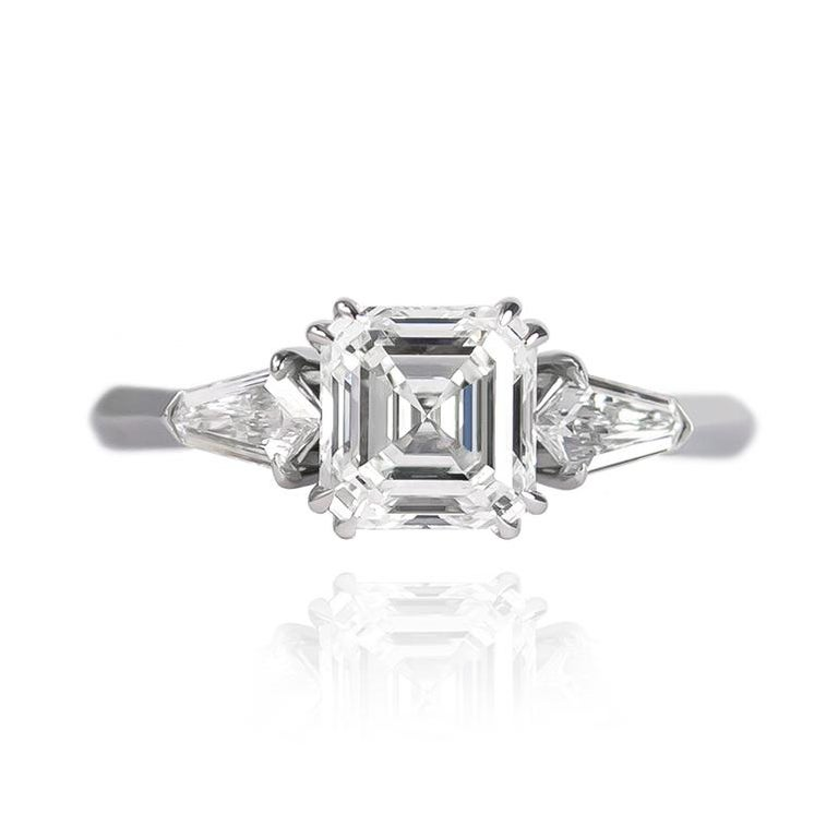 This edgy and fierce ring features a 1.60 carat Asscher cut diamond of F color and SI2 clarity set in a handmade platinum ring with kite side stones = 0.34 ctw. This geometric pairing of shapes is elegant and reminiscent of the Art Deco era -