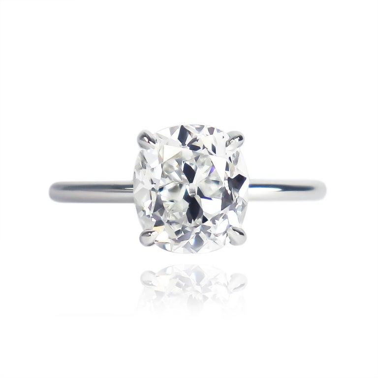 This perfect marriage of contemporary craftsmanship and antique diamond cutting from the J. Birnbach workshop features a 2.13 carat cushion brilliant cut diamond of G color and VS2 clarity... Set in a sleek, platinum, solitaire ring with a flush-fit