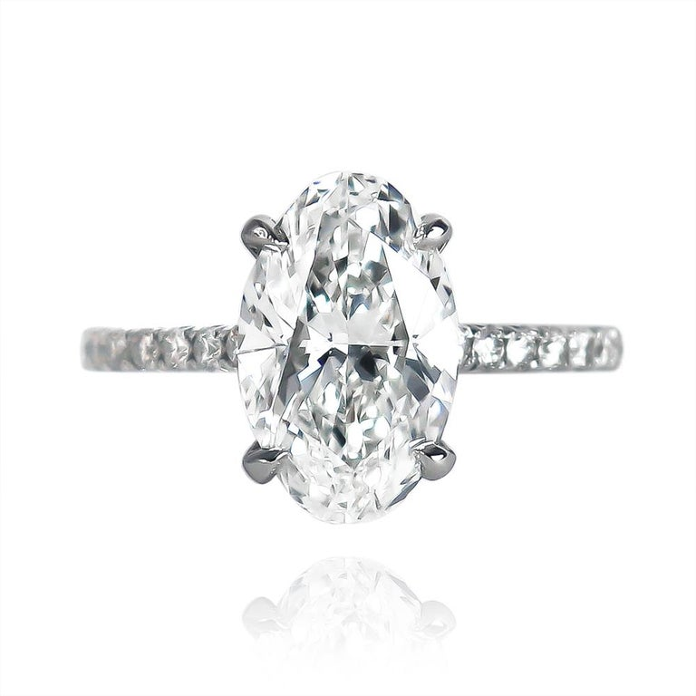 This scintillating and romantic ring from the J. Birnbach collection features a 2.92 carat oval brilliant cut diamond of G color and SI1 clarity. 100% eye-clean with an elongated outline that flatters the finger, this diamond is set in a handmade,