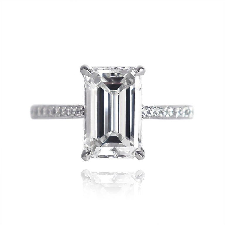 This breathtaking ring from the J. Birnbach workshop features a 3.01 carat Emerald cut diamond of D color and SI1 clarity... Set in a handmade, platinum ring with pavé details = .022 ctw, the combination of brilliant and step-cut diamonds is