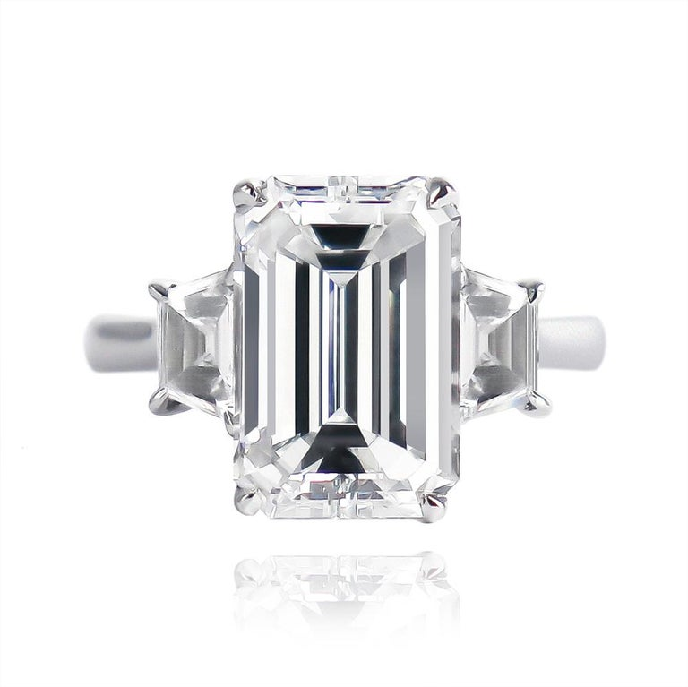 Another classic from the J. Birnbach workshop features a GIA certified 3.50 carat Emerald cut diamond of E color and VVS2 clarity. Set in a platinum, three-stone ring with step-cut trapezoid sidetones = 0.54 ctw, this elegant piece is guaranteed to