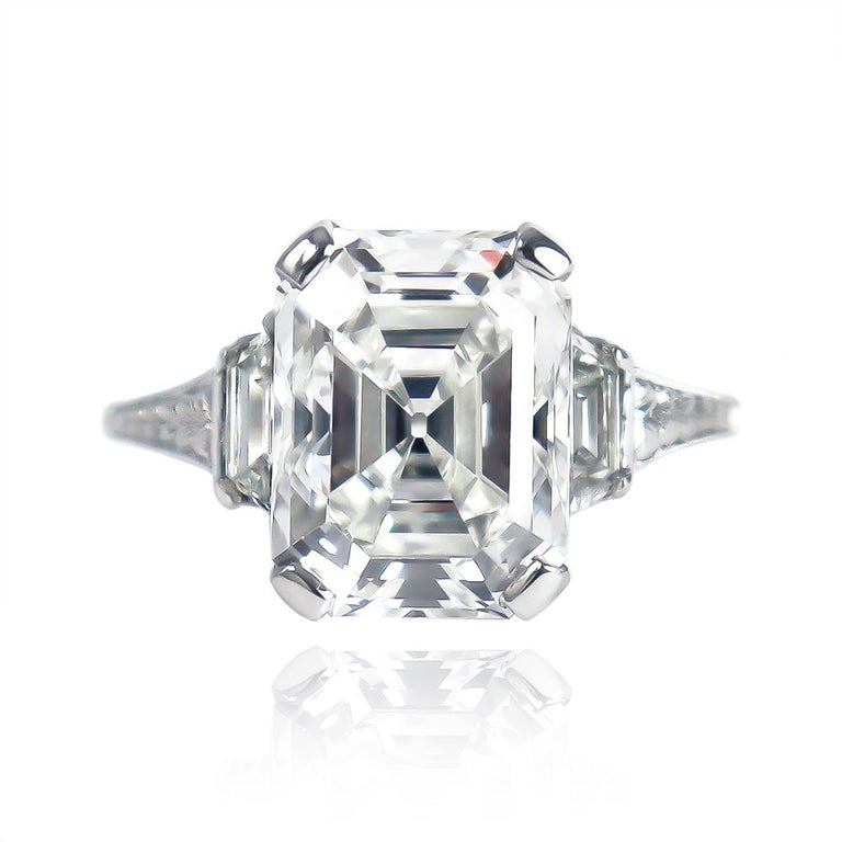 This breathtaking, vintage ring from the J. Birnbach collection features a GIA certified 4.12 carat emerald cut diamond of F color and SI1 clarity... As a 100% eye-clean SI1, this stone's depth allows for scintillating play of light with a charming,