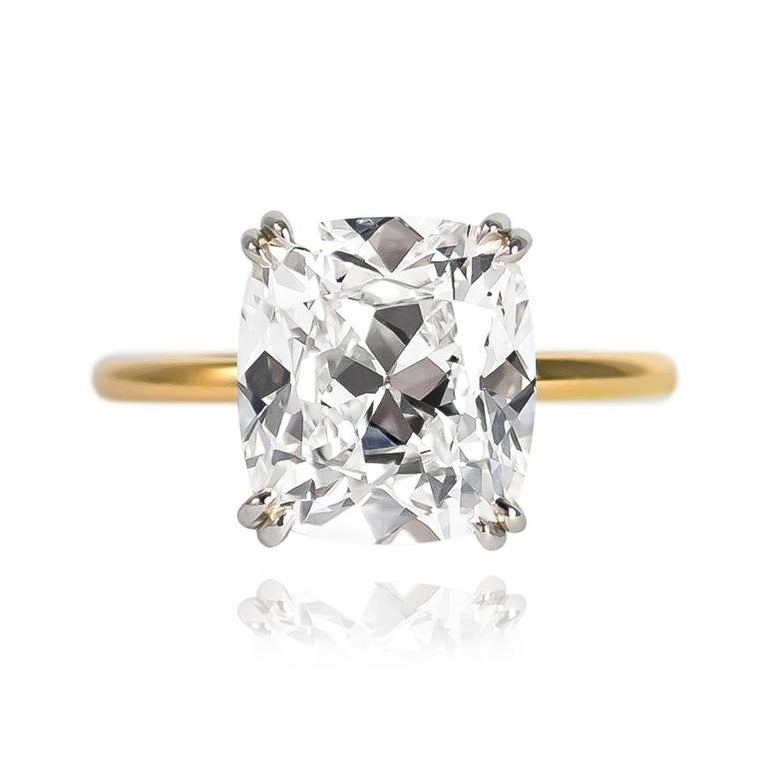This new, sleek ring from the J. Birnbach workshop features a 4.21 carat Cushion Brilliant cut diamond of H color and VS1 clarity... Charming to the max, this diamond is set in a handmade, platinum and 18K yellow gold solitaire ring with double claw