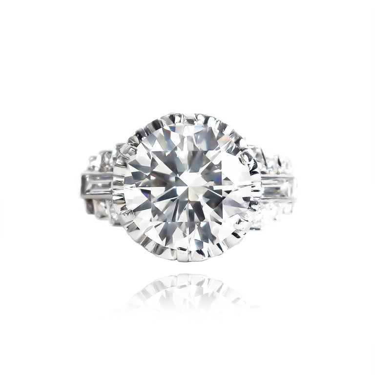 This incredible, recently-restored, vintage piece from the J. Birnbach collection features a GIA certified 4.51 carat round brilliant diamond of I color and SI1 clarity. Set in a phenomenal vintage mounting with straight baguettes and assorted