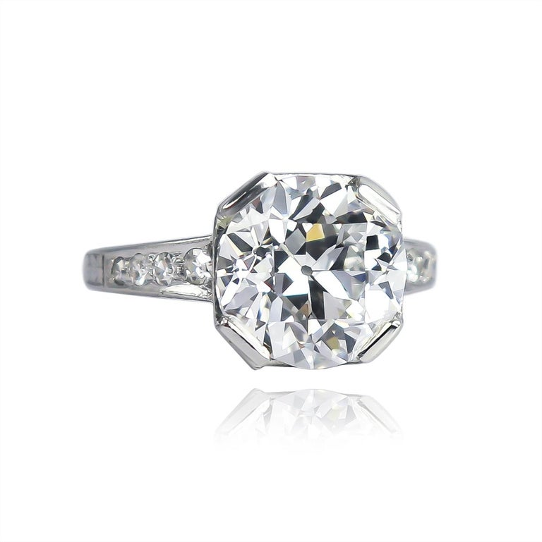 This incredible vintage ring from the J. Birnbach collection features a GIA certified 4.68 carat Old European cut diamond of E color and VS2 clarity... Set in a platinum, vintage ring with assorted single-cut diamonds, this piece is charming and