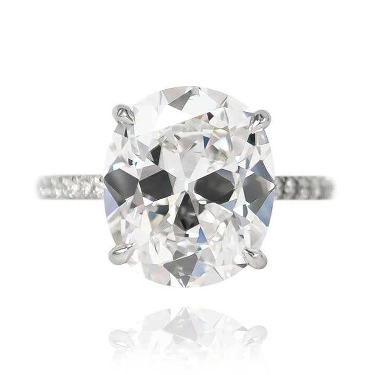 This incredible piece from the J. Birnbach vault features a breathtaking 5.23 ct Cushion Brilliant cut diamond of E color and VS2 clarity. Scintillating at every turn, this stone is set in a handmade, platinum pavé ring with 0.24 ctw of brilliant