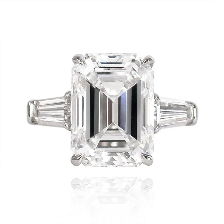 This breathtaking J. Birnbach ring is a timeless classic featuring a 5.43 ct Emerald cut diamond of E color and VVS2 clarity. Set in a handmade platinum ring with tapered baguettes = 0.80 ctw, this ring is beyond mesmerizing from every angle!