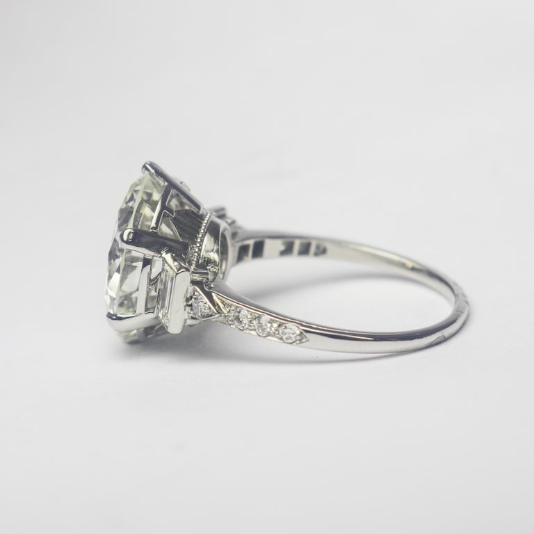 This exquisite, Art Deco style ring from the J. Birnbach workshop features a GIA certified 7.82 carat round brilliant cut diamond of J color and VS1 clarity as described by GIA grading report #5212515536. Set in a handmade, platinum ring with