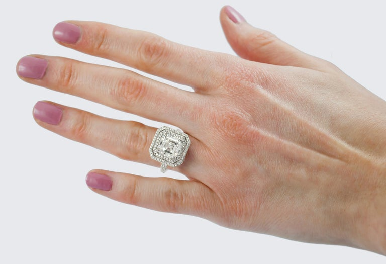 This GIA certified diamond comes only from the diamond house J. Birnbach. Weighing in at 4.09 carats with an F color and VVS1 clarity and surrounded by a double row of pave that equals 0.66 carats for a total weight of 4.75 carats for the entire