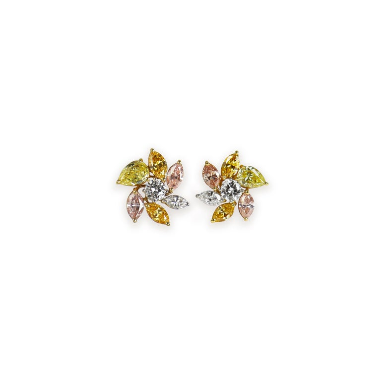 This exquisite pair of earrings from the J. Birnbach vault features an incredible combination of natural, fancy colored diamonds ranging in hue from intense yellows, beautifully saturated oranges, and sophisticated pinks.  Set in platinum, 18K