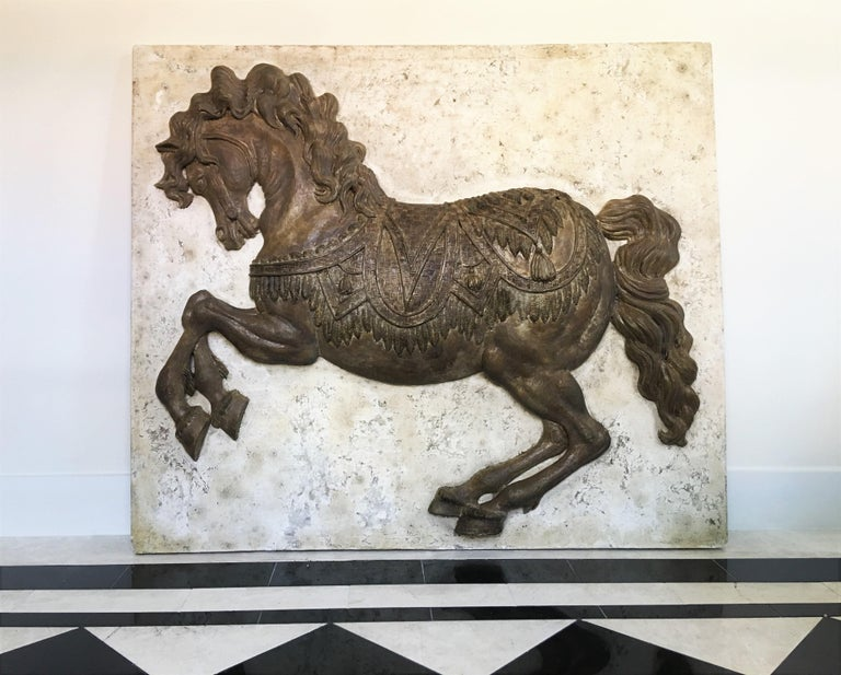 One-of-a-kind plaster wall panel by Harold Studios, Inc. circa 1950s. The highly detailed hanging sculpture depicts a raised molded detailed running horse and will make a dramatic impact wherever it is employed. There are hooks on the back so you