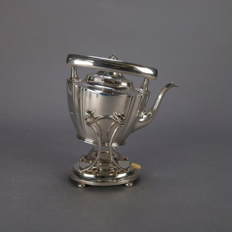 Sterling silver teapot by J.E. Caldwell & Co. feature tapered vessel with swivel handle and seated on footed warming Stand with burner, maker marks on base as photographed, total weight 44.12 toz (27.89 toz teapot only), 20th century  ***DELIVERY
