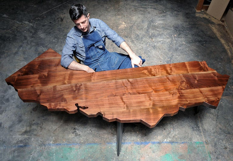 Since 2007, J. Rusten Furniture Studio has been creating the original and now familiar California Series of tables and desks. Carefully cut into the iconic shape of California, each piece is crafted from locally salvaged Claro walnut and features