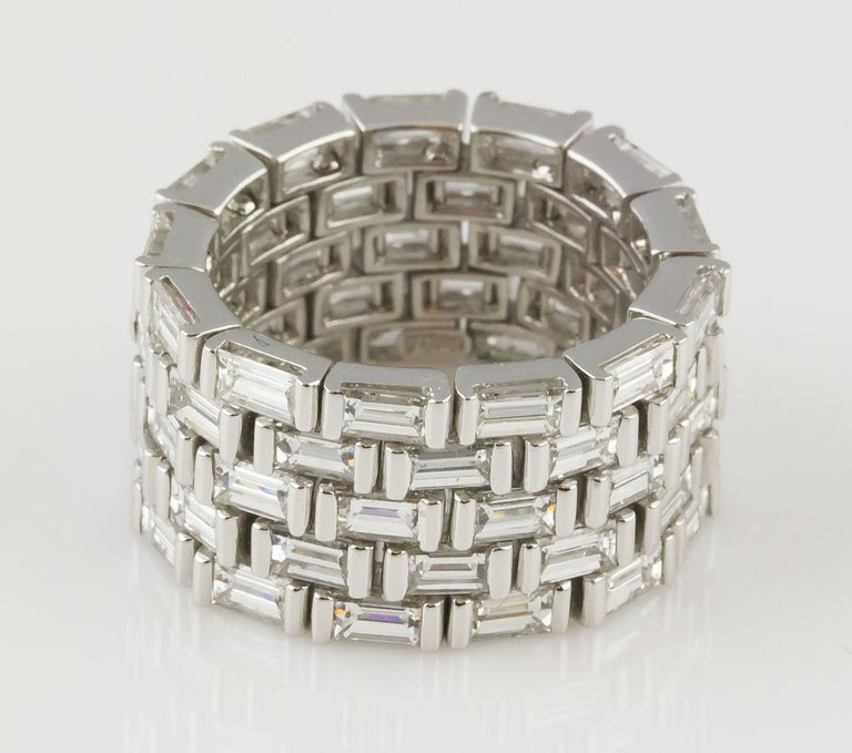 Very fine platinum and diamond flexible band ring by J. Stella. It features approx. 10 cts of very high quality baguette cut diamonds. Size 7.  Hallmarks: J. Stella, PT950, 750.
