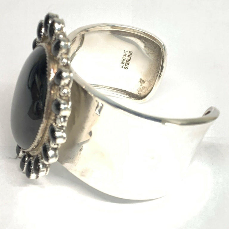J. Wright Estate Navajo Sterling Silver Onyx Cuff Bracelet GS-1  New Vintage Statement Cuff Bracelet adorned with Oval Black Onyx Stones. Hand crafted and signed by the very prestigious Navajo artist  J. Wright.   Measures  Measures 2.5