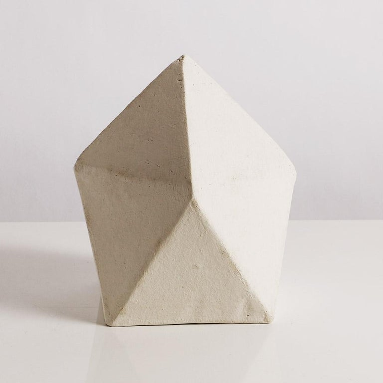 This one-of-a-kind handmade geometric ceramic sculpture is assembled from flat sheets of a sandy stoneware and finished with a velvety whitewash finish. It is part of an ongoing series of sculptures exploring complex geometric forms based on a small