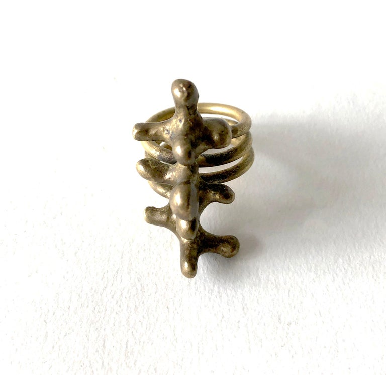 Bronze spore ring created by Jack Boyd of San Diego, California.  Ring is a finger size 6 and measures 1.5