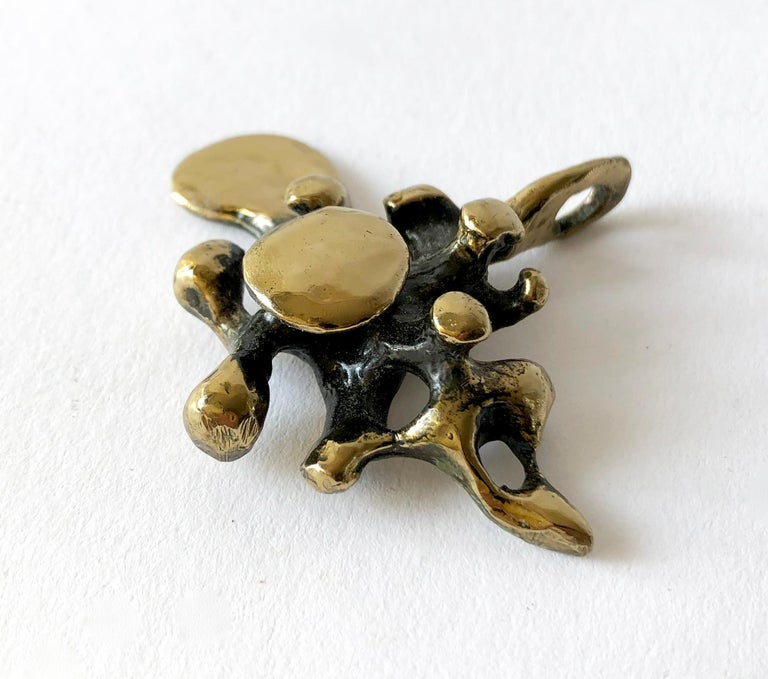 Bronze spore pendant created by sculptor and jeweler Jack Boyd  of San Diego, California. Pendant measures 2 1/8