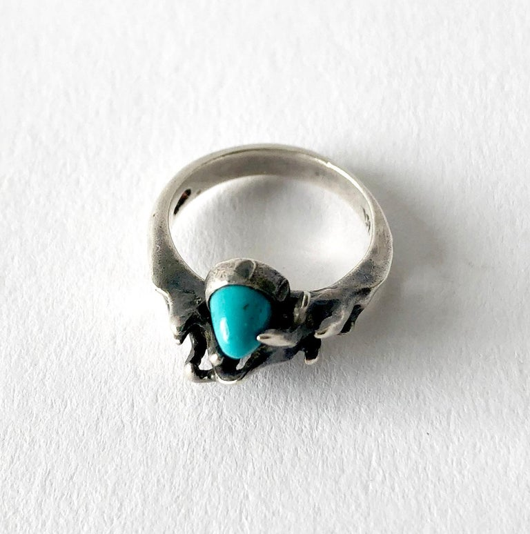 Sterling silver and turquoise organic modernist ring created by sculptor and jeweler Jack Boyd of San Diego, California.  Ring is a finger size 6 and is signed with the artists hallmark of JB.  A modern alternative to an engagement or wedding ring.