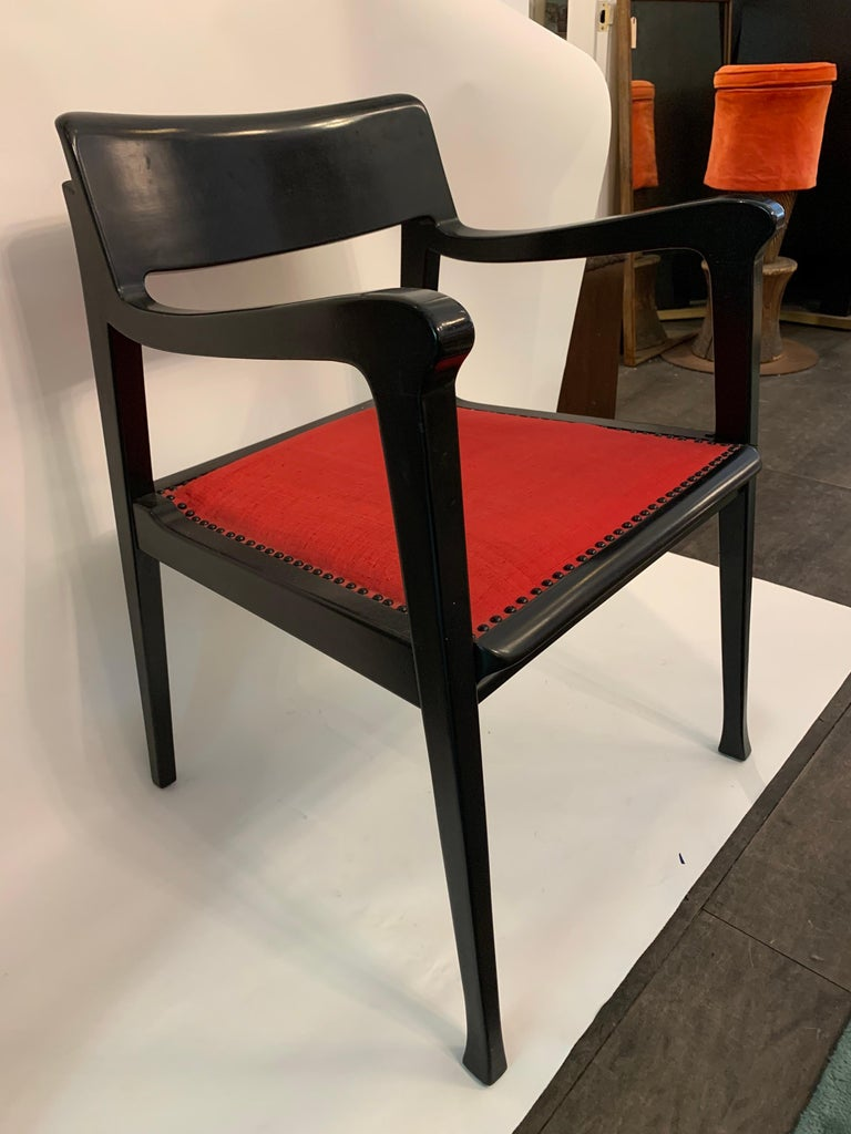 Retains original signed brass metal tag underneath, this Riemerschmid armchair, was designed by Jack Lenor Larsen. It is upholstered in original J.L.L fabric and finished with black nailhead trim. A black Walnut frame makes this a stunning crafted