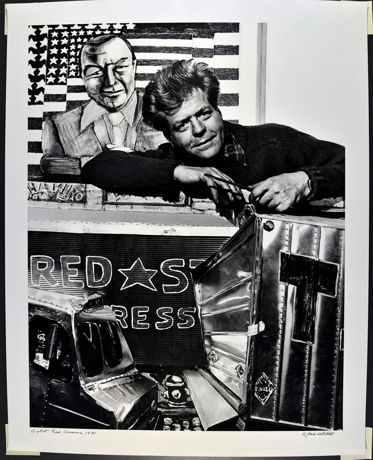 "16 x 20"" vintage silver gelatin photograph of artist Red Grooms in his studio, photographed in 1981. It is signed by Jack Mitchell on the recto and in pencil on the verso. Comes directly from the Jack Mitchell Archives with a certificate of"