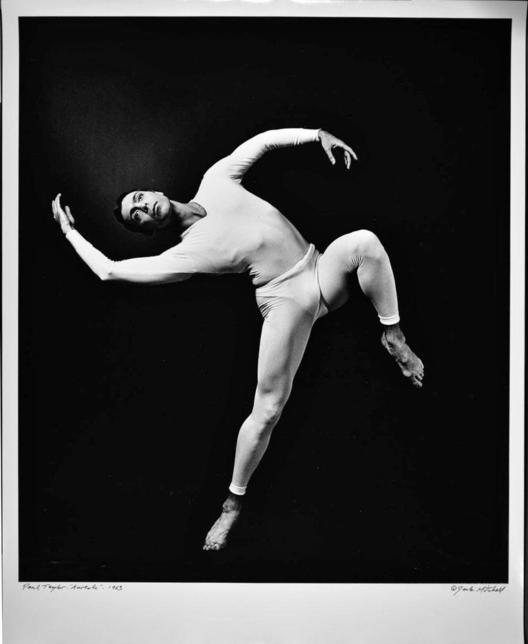 """16 x 20"""" vintage silver gelatin photograph of dancer/choreographer and dance company founder Paul Taylor performing his work 'Aureole' in 1963. It is signed by Jack Mitchell on the recto and in pencil on the verso. Comes directly from the Jack"""
